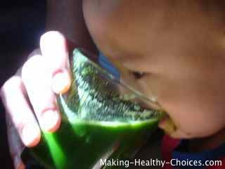 Baby Drinking Green Juice