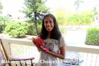 Nadia holding Cacao Pod